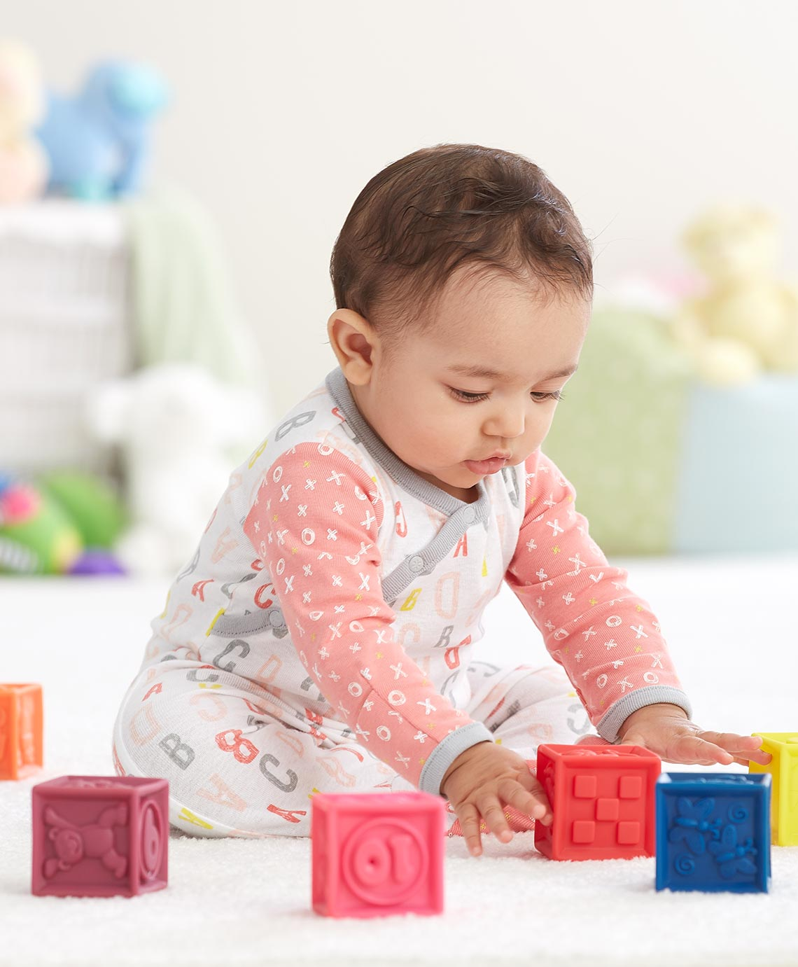 Infant baby playing with toys photographed by commercial photographer, Jim Esposito.